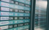 A flight information screen at an airport.