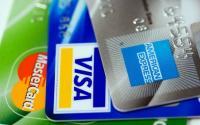 A stack of American Express, Visa and Mastercard credit cards.