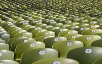 Rows of empty stadium seats.