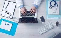 Doctor at a computer. Photo via Pixabay.