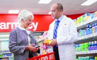 CVS pharmacist helping a customer shopping.