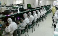 Workers inside a Foxconn factory.