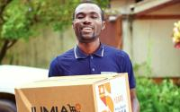 A man with a Jumia delivery box.