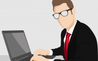 An illustration of a businessman at a computer.