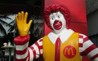 Ronald McDonald outside of a McDonald's restaurant.