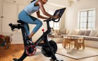 Woman riding a Peloton bike.