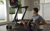 A man exercises with a Peloton.