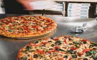 How much better was investing in Domino's Pizza than Apple, Netflix, Microsoft.