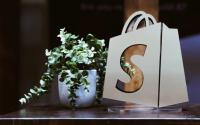 A bag with a Shopify logo.