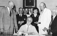 Photo: President Roosevelt signs Social Security Act.