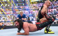 WWE stars Roman Reigns and Cesaro in action. Courtesy of WWE