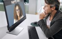 A man and woman speak on a Zoom video call.