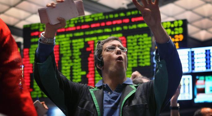 Mid-Afternoon Market Update: Markets Dip Despite Large Amount of M&A