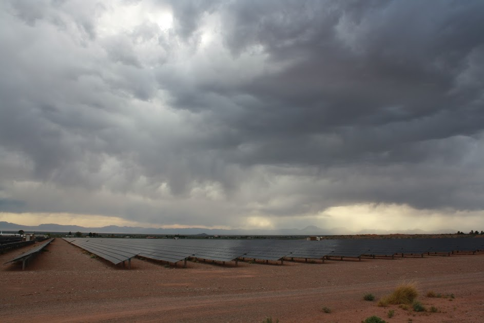 Figure 1: As rain clouds gather over the Otero County Solar Energy Center, near Alamogordo, New Mexico, U.S.A., the White House announced plans to withdraw from the climate-friendly Paris agreement. Photo by Jeffrey R. Bacon.